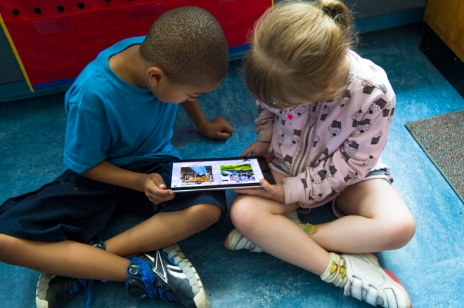 Students reading an ebook on an iPad