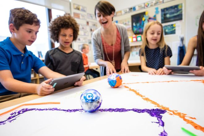Students using Spheros to draw shapes with paint