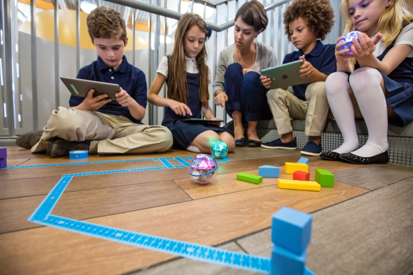 Image of students playing with Sphero robots
